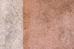 Dirty two colored wall, detailed. Old dirty two colored wall, beige and brown, detailed texture background stock photos