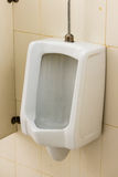 Dirty urinal on wall Royalty Free Stock Images
