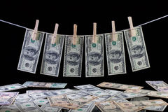 Dirty US dollar banknotes hanging from a clothesline Stock Image