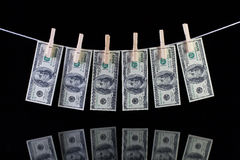 Dirty US dollar banknotes hanging from a clothesline Royalty Free Stock Photos