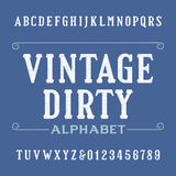 Dirty vintage alphabet font. Distressed serif letters and numbers. Royalty Free Stock Images