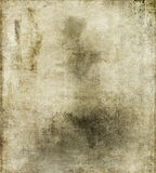 Dirty Vintage Paper. A background of a dirty vintage paper with a grunge pattern on it Stock Image