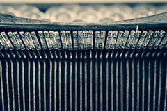Dirty vintage typewriter keyboard focusing on the typebars. With a retro feel Royalty Free Stock Photo
