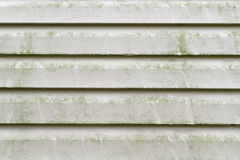 Dirty Vinyl Siding Needs Pressure Washing. Green algae, mold, and dirty grime on a section of a residential homes' vinyl siding exterior. The green algae Royalty Free Stock Photos