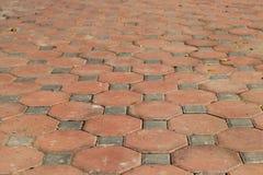 Dirty of walkway brick in octagon shape. Octagon brick, orange walkway Royalty Free Stock Photos