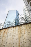 Dirty wall and barbwire in modern city Stock Photography