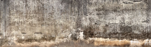 Dirty wall with broken cement plaster. Stock Images