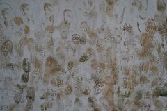 Dirty wall with footprints. Background stock photography