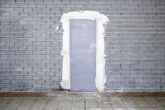 Dirty wall with metal doors. Works in the city Stock Images