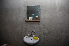 Dirty washbasin in an old poor house. A dark, sombre abstract scene about poverty and housing problems. stock photo