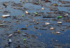 Dirty water. Environment polluted by plastic rubbish Stock Images
