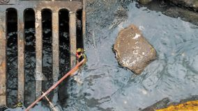 Dirty water flowing into a storm water sewer system. Pollution goes to the municipal sewerage system in the street