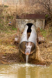 Dirty water to the river on industrial from a pipe Stock Photo
