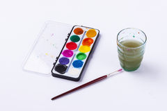 Dirty water and watercolours on white background. Royalty Free Stock Photos