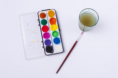 Dirty water and watercolours on white background. Royalty Free Stock Images