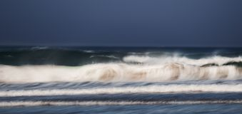 Dirty waves at beach stock photography