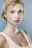 Dirty and wet hair young lady. Dirty and wet hair nice blonde girl posing in studio for personal portraits royalty free stock photo