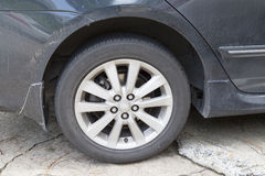 Dirty wheel of black cars Royalty Free Stock Photos