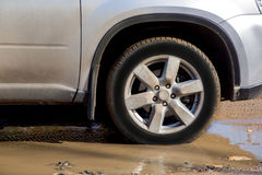 Dirty wheel of the car. Royalty Free Stock Photo