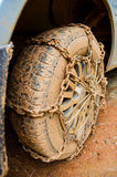Dirty wheel with chain Royalty Free Stock Photo