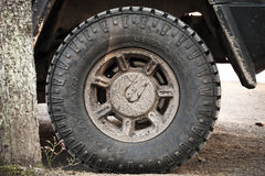 Dirty wheel with logotype of a Hummer H2 car Stock Images