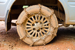 Dirty Wheel With Chain Stock Photography