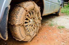Dirty Wheel With Chain Stock Photos
