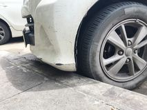 Dirty white car crashed parked. stock image