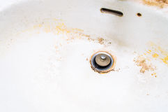 Dirty white ceramic sink. Royalty Free Stock Image