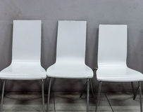 Dirty white chair with metal leg. Stock Photo