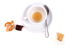 Dirty white cup of tea and sweets crumbs Royalty Free Stock Photos