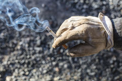 Dirty white glove and fuming tobacco in Finland. Stock Photography