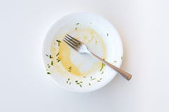 Dirty white plate Stock Photo