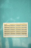 A dirty white ventilation window. On light blue plastic door Stock Photography