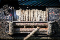 Dirty winch on car. Close up shot of a dirty winch from an off road car Royalty Free Stock Image