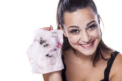 Dirty wipe. Nice beautiful girl shows dirty wet wipe used to remove her makeup Stock Photography
