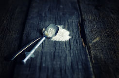 Dirty wooden floor with drug syringe spoon cocain Royalty Free Stock Photos