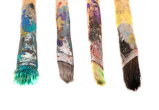 Dirty wooden paint brushes isolated on white royalty free stock image