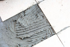 Dirty work, but beautiful complete, tile for floor Stock Photo