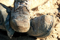 Dirty work boots. Close-up of a pair of very dirty construction boots Stock Photography