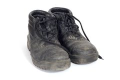 Dirty work boots. A pair of safety boots dirty after a day at work Royalty Free Stock Photos