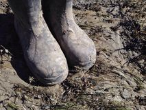 Dirty work boots. Royalty Free Stock Photography