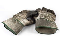 Dirty work gloves. On white Stock Photos