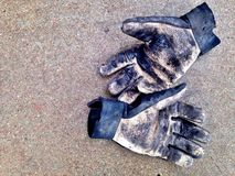 Dirty work gloves Royalty Free Stock Photography
