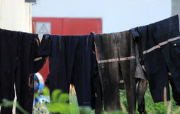Dirty Worker Clothes on Washing Line Stock Image