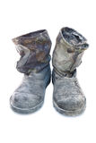 Dirty Working Boots. Pair of Old Dirty Working Boots isolated Royalty Free Stock Photo