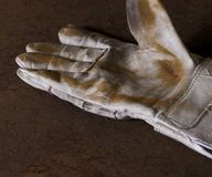 Dirty working glove Stock Image