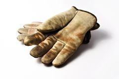 Dirty working gloves. Dirty leather working gloves, white background royalty free stock image