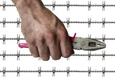 Dirty workman hand hold a plierspincer isolated on white background. Close Stock Images