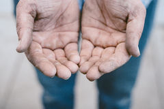 Dirty workman's hands Stock Images